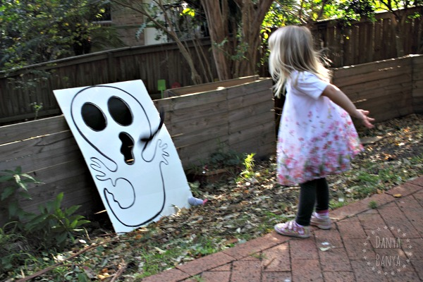 DIY ghost and skull boards for cornhole / bean-bag toss game for Halloween or a Spooky Party
