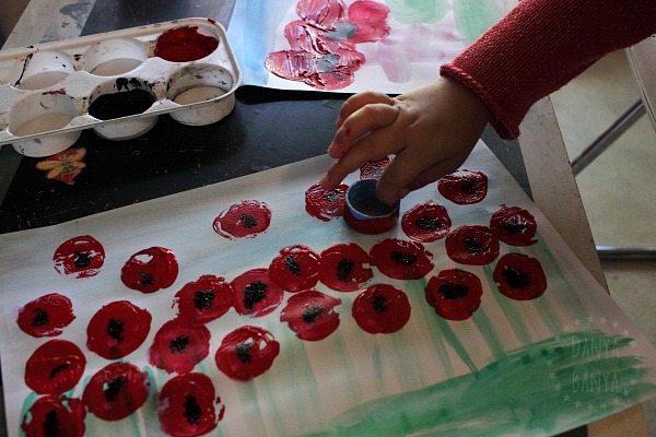 3-year-old-painting-poppies-with-a-bottle-cap-preschooler-art-for-anzac-day-or-remembrance-day