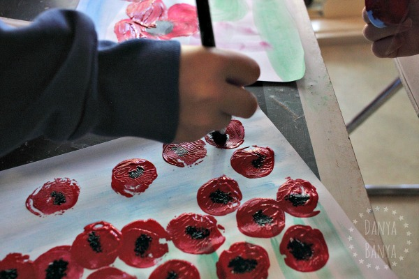 painting-the-black-centre-of-the-poppy-an-anzac-day-painting-to-remember-those-fallen