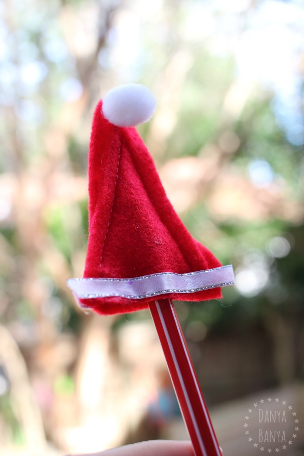 Homemade Santa hat pencil toppers - cute non-candy DIY Christmas gifts for kids to give their classmates or friends