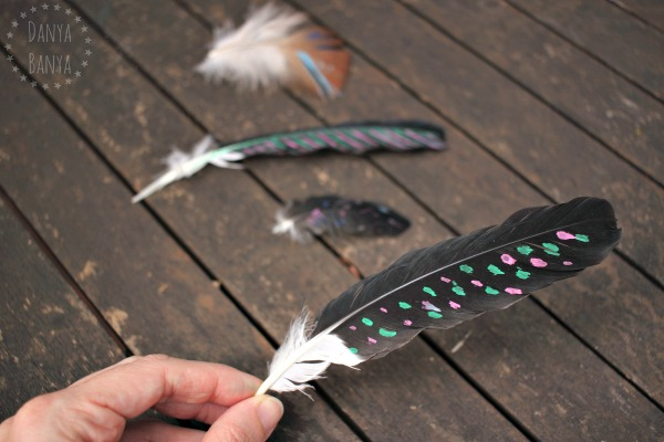 Painting on feathers with paint pens - fun nature process art idea for kids