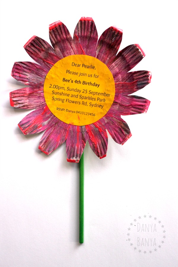 Easy DIY flower birthday party invitations, with chopstick stems, that kids can help make! My daughter loved this craft, but she especially loved handing them out to all her friends!