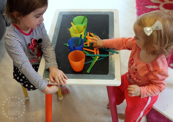 Sorting craft sticks by colour