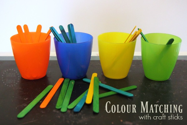 Toddler colour matching activity using craft sticks
