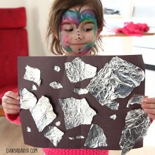 Tearing and pasting aluminium foil for fine motor play